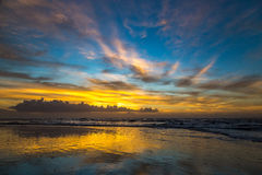 Sunrise over Amelia. The sun rises at the beach on a cloudy morning over Amelia Island, Florida stock photography