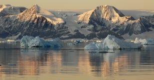 Sunrise over Antarctica. Antarctic mountains at the Peninsula at sunrise Stock Images