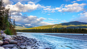 Sunrise over the Athabasca River. Near the town of Jasper in Jasper National Park in the Canadian Rocky Mountains royalty free stock image