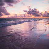 Sunrise over Atlantic Ocean, Bavaro. Colorful sunrise over Atlantic Ocean coast, Bavaro beach, Hispaniola Island. Dominican Republic, coastal landscape. Square Royalty Free Stock Images