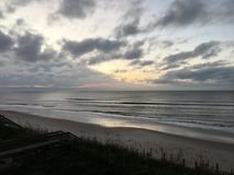 Sunrise over the Atlantic Ocean Coastline, North Carolina. Sunrise with clouds and ocean waves off the Atlantic coast of Topsail Island, NC Stock Photography