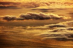 The sunrise over the Atlantic Ocean seen from Pico Volcano. Clouds formation at sunrise over the Atlantic Ocean, seen from Pico volcano 2351m, Pico Island Royalty Free Stock Image