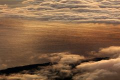 The sunrise over the Atlantic Ocean seen from Pico Volcano. Clouds formation at sunrise over the Atlantic Ocean, seen from Pico volcano 2351m, Pico Island Stock Image