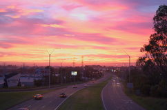 Sunrise pink purple over highway in Australian city Stock Image