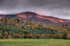Sunrise over autumn mountains Stock Photos