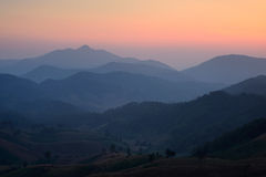Sunrise over layer mountains Stock Photography