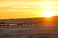 Sunrise over the Baltic Sea. With groynes Stock Photos