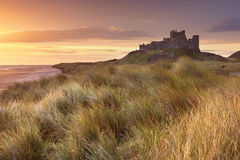 Sunrise over Bamburgh Castle, England Stock Photography