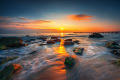 Sunrise over the beach. Beautiful cloudscape over the sea, sunrise shot Royalty Free Stock Images