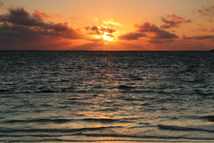Sunrise over a beautiful blue ocean Royalty Free Stock Photo