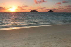 Sunrise over a beautiful white sand beach Stock Images