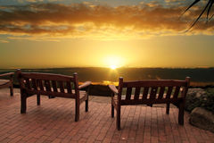 Sunrise Over Benches Royalty Free Stock Photography