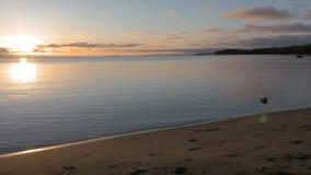 Sunrise over a big beautiful lake. A beautiful start to a new day. 4K stock video