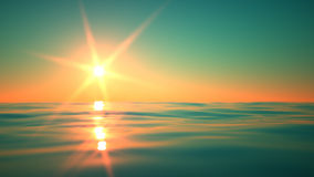 Sunrise over a blue tranquil sea. Sunrise over traquil sea with gently rippling waves. A 3D rendering Royalty Free Stock Images