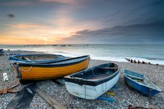 Fishing Boats at Selsey. Sunrise over boats on the beach at Selsey in West Sussex Stock Photography