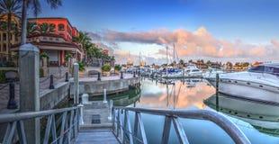 Sunrise over the boats in Esplanade Harbor Marina in Marco Island. Florida stock photography