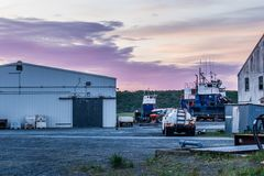 Sunrise over a boatyard in Ekuk Alaska on Bristol Bay. royalty free stock photography