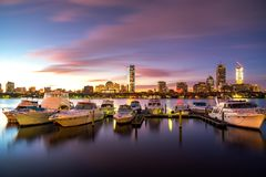 Sunrise over Boston city with boat and harbor stock photo
