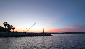 Sunrise over Breakwater / jetty for the Puerto San Jose Del Cabo harbor / marina in Baja Mexico Stock Images