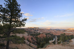Sunrise over Bryce Canyon. The rising sun touches distant hilltops at Bryce Canyon National Park Stock Photos