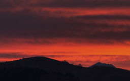 Sunrise over Bucovina. Red sky over Bucovina region, Romania, on the Easter morning of 2015 Royalty Free Stock Photo