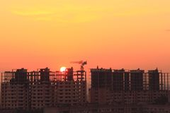 Sunrise. Over a building under construction stock photos