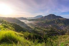Sunrise over the caldera of Batur volcano in Bali Royalty Free Stock Photos