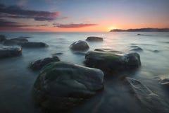 Sunrise over a calm sea at Arribolas beach in Bermeo. Bizkaia Stock Photos