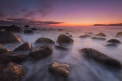 Sunrise over a calm sea at Arribolas beach in Bermeo, Bizkaia. Sunrise over a calm sea at Arribolas beach in Bermeo Royalty Free Stock Photography