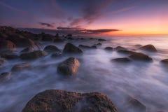Sunrise over a calm sea at Arribolas beach in Bermeo. Bizkaia Stock Photo