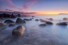 Sunrise over a calm sea at Arribolas beach in Bermeo. Bizkaia Royalty Free Stock Image
