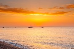 Sunrise    over the calm sea in orange tones Stock Photo