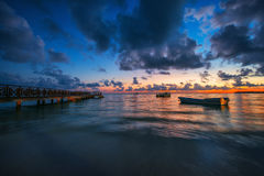 Sunrise over the Caribbean sea. And boat Royalty Free Stock Photography