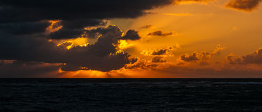 Sunrise over Caribbean Sea - Mexico. Photo of Cloudy sunrise over Caribbean sea - Mexico, Riviera Maya Stock Image