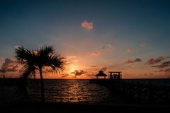 Sunrise over the Caribbean sea. Picture taken from the island of Caye Caulker, Belize Stock Image