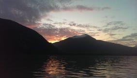 Sunrise over the cascadia coast stock images