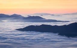 Sunrise over Cataloochee Valley, Asheville, North Carolina. Sunrise over clouds surrounding hills Cataloochee Valley near Asheville, North Carolina Stock Images