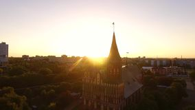 Sunrise over the cathedral. Bird-eye view of the cathedral of Kaliningrad in sunrise stock footage