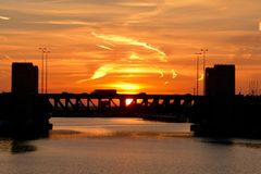 Sunrise Over The Chicago River. This is a Fall picture of a sunrise over the Chicago River featuring traffic on the Lake Shore Drive Bridge located in Chicago stock photos