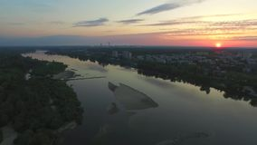 Sunrise over the city and the river aerial view, dji inspire. Sunrise over the city and the river, aerial footage, Puławy, green city at the east, sunrise in stock footage
