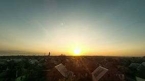 Sunrise over the city. The sun rises over the. Morning dawn. Bright red, yellow sun rises on the horizon, blue sky. The sky is clear and some clouds on the stock video