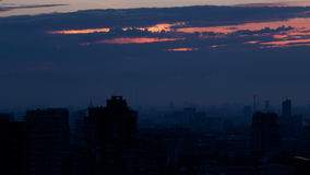 Sunrise over the city. Time lapse with panning. stock footage
