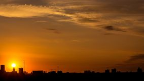 Sunrise over the city time lapse stock footage