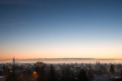Sunrise over cityscape and fog. Stock Images