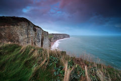 Sunrise over cliff in ocean. Etretat, Normandy, France Royalty Free Stock Photos