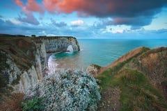 Sunrise over cliffs in Atlantic ocean Stock Photography
