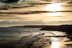 Sunrise over cliffs and beach Royalty Free Stock Images