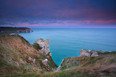 Sunrise over cliffs in ocean. Normandy Royalty Free Stock Photography