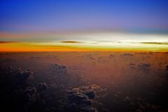 Sunrise over the clouds Stock Image