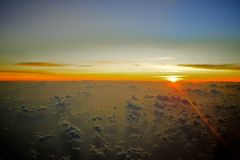 Sunrise over the clouds Stock Photos